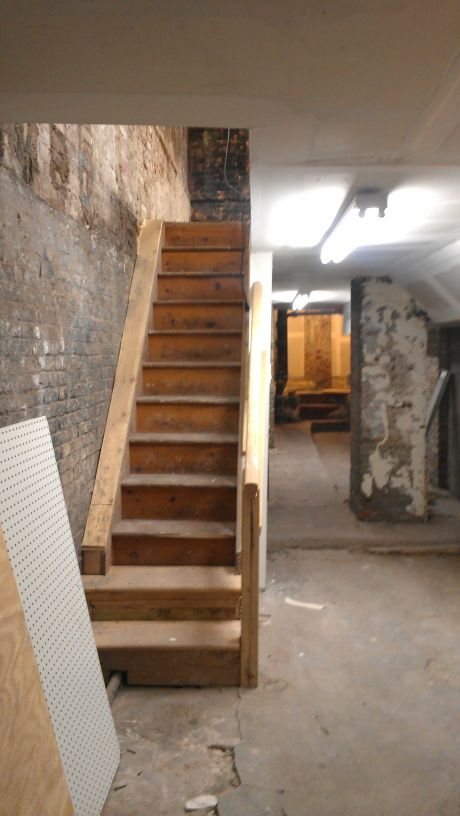The basement stairs to the ground floor