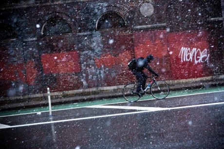 A New York City cyclist biking in the winter. Credit: Getty Images.